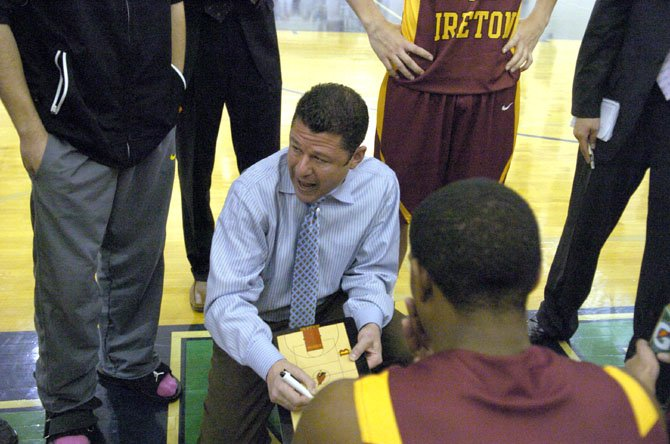 Bishop Ireton boys basketball coach Neil Berkman talks to the Cardinals during a game against Flint Hill on Jan. 5.