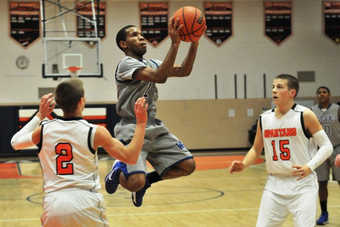 West Potomac point guard Brandon Pressley goes up for a shot against West Springfield on Jan. 8.