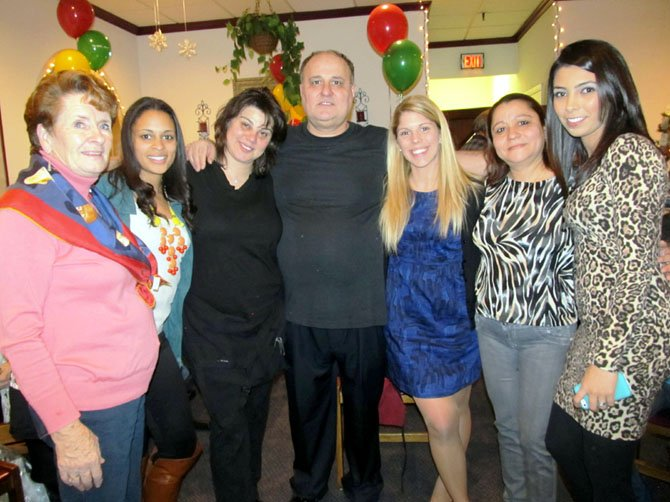 Former and current employees celebrate Milano's 33rd anniversary and owner Jimmy Goranitis' 55th birthday during a surprise party Saturday, Jan. 5. (From left) are Judy Kirk, Larissa Cookson, Kayse Krilis, Jimmy, Kalia Sokos, Alina Paulakos and Sahar Williams. Krilis and Kirk organized the party.