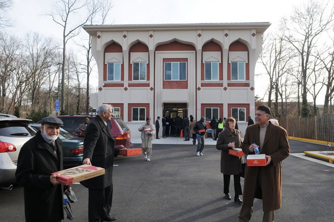 Guests leave in newly opened Islamic Circle of North America-VA(ICNA-VA) mosque after opening ceremonies last Saturday afternoon. The Mount Vernon mosque, a million-dollar-project, features five Islamic arches.