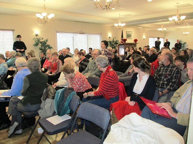Vienna resident Lisa Arlt Escoto (standing), was one of nearly 200 residents to attend Saturday's town hall meeting hosted by Senator Chap Petersen (D-34) and Delegate Mark Keam (D-35).