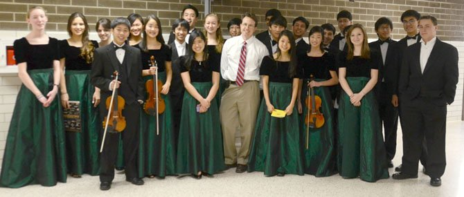 Langley HS District Orchestra students with Dr. Scott McCormick, Langley HS Orchestra Director. From left, first row: Kevin Tan, Lauren Kim, Julia Hara, Dr. Scott McCormick, Rebecca Oh, Ashley Zhang, Madeline Thompson; second row - Penelope Mort-Ranta, Nirosha Beekhuysen, Alexandra Cramer, Claire Lee, Alan Chiang, Brandon Tran, Grace Keffer, Gene Kim, (hidden), Alex Lim, Alex Quion, Harrison Nam, Zach Chou, Cliff Yang (hidden), Jonathan Grow, Alex Blankenship.