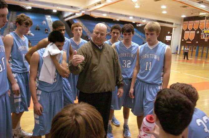 Yorktown boys basketball coach Rich Avila speaks to the Patriots during a Jan. 14 game against Hayfield.