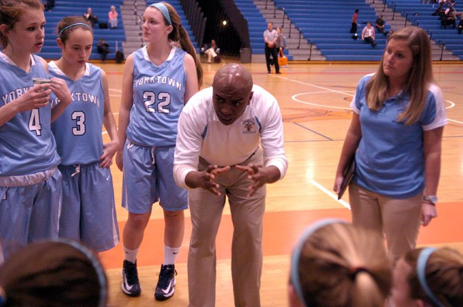 Yorktown head girls' basketball coach Devaughn Drayton talks to the Patriots during a Jan. 14 game at Hayfield.