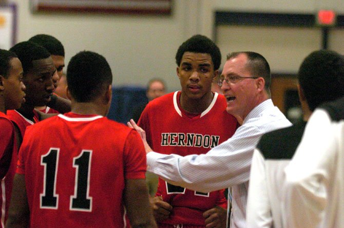 Herndon boys basketball coach Gary Hall speaks to the Hornets during a Jan. 10 game at Chantilly.