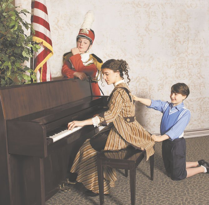 "Jake Land of Potomac is cast as Harold Hill in Bravo@Kat theatre for young artists' production of ""The Music Man"" at the Olney Theatre Center this weekend. Josie Weinberg is Marian Paroo and Cole Edelstein is Winthrop Paroo."