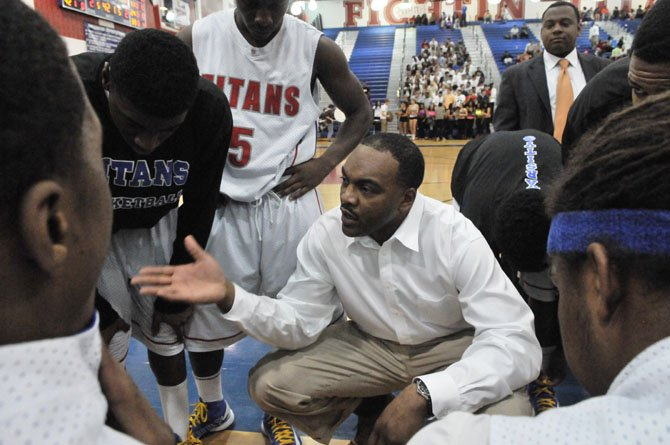 T.C. Williams boys' basketball coach Julian King talks to the Titans during a Jan. 11 game against Lake Braddock.