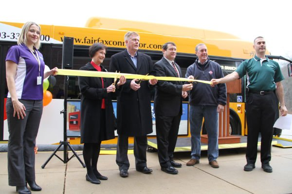 Cutting the ribbon on the new Express Connector Service, from left, Christin Wegener, planning operations manager, Fairfax Connector, County Board Chair Sharon Bulova, Supervisors John Cook (R- Braddock) and Pat Herrity (R- Springfield), VRE CEO Doug Allen, FCDOT Director Tom Biesadny.
