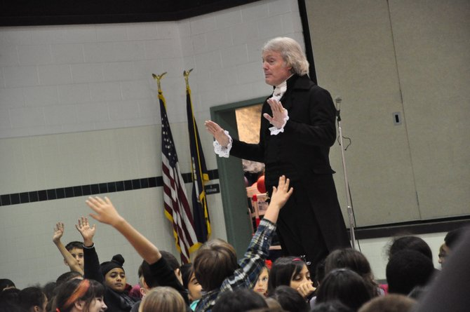 Bill Barker, who plays Thomas Jefferson at Colonial Williamsburg, answers questions from students at Hunters Woods Elementary School Wednesday, Jan. 9, one of six stops he made over two days at local schools.