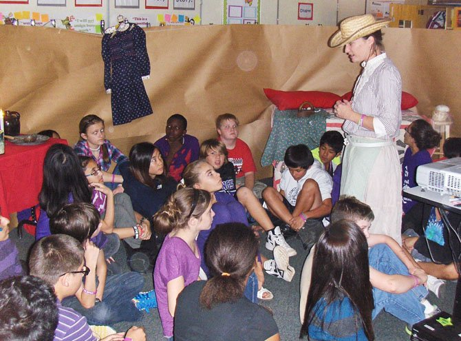 Teacher Maggie Brown addresses Rocky Run seventh-graders as Nebraska homesteader Prairie Annie.