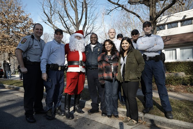 Santa and the West Springfield District Police Station joined with members of the Green Hills community on Saturday, Dec. 15, to share some holiday spirit and celebrate the progress the community has made with police help towards becoming safer after shootings and drug related occurrences over the past year. (From left, back row) MPO J.T. Frey, Lt. Jim Tanler, Santa (PFC Tom Champ), Captain Joe Hill, PFC Nate Vanhusen, PFC Rex Pagerie, PFC Rob Asencios, Ryan Quarto and two Green Hills community members.