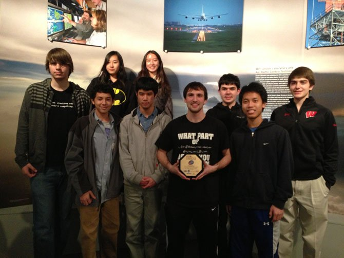 Local students competed in the ZERO Robotics Challenge at the Massachusetts Institute of Technology (MIT) earlier this month. Front row, from left, are Peter Jablonski, Alexander Fang, Jesse Pai, Justin Schumacher, Andrew Kee; second row, from left, are Diana Yin, Amy Lin, Samuel Platt and Eric Rosenberg.