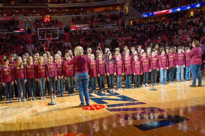 Chorus Directors Deborah Rudd and Marilyn Harwood during the Jan. 12 performance at the opening of the Wizards basketball game (vs. the Atlanta Hawks). The 70-member chorus filled the 20,000-seat arena with the sweet sounds of the National Anthem.