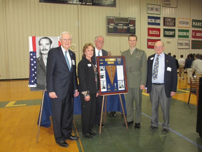 Skip Coston, chairman, Flint Hill School Board of Trustees; Society Curator Judith Shoemaker; Flint Hill School Headmaster John Thomas; British Royal Marine Major Simon Tucker, representing British Embassy and president of the Ferguson-Warren Society; and Jerry Jasper, presenting Colonel Alan Ferguson-Warren's regimental dagger to Flint Hill School on Friday, Jan. 18.