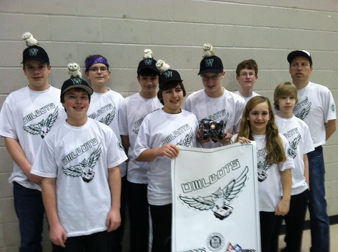 Owlbots: Front row, from left, are JD McLean, Anthony Mahshigian, Winston Grenier (with robot), Sarah Bash and Darius Kuddo. Back row, from left, are Chris McCormick, Jonah Barron, Noah Montemarano, Jack Wenger and Coach Jeff Oosterhout.
