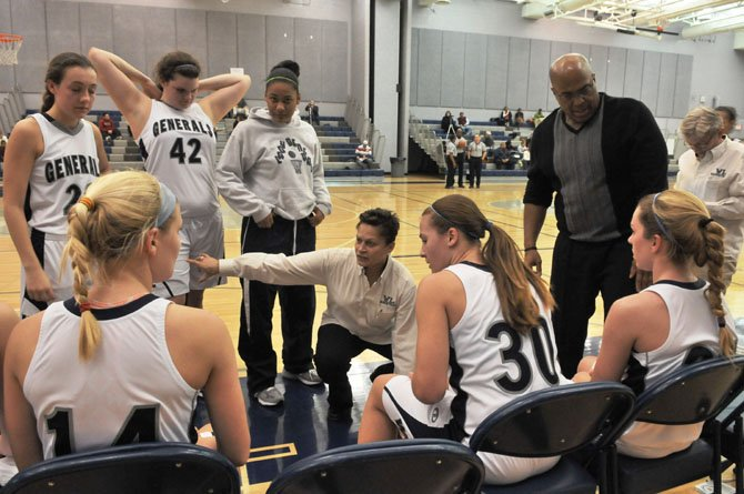 Washington-Lee head girls' basketball coach Angie Kelly talks to the Generals during a Jan. 17 game against Mount Vernon.