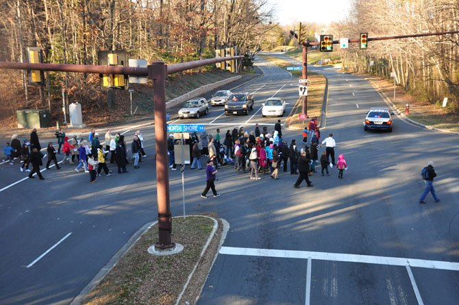 The commemorative march to honor Martin Luther King crosses Wiehle Avenue on its way to the Northern Virginia Hebrew Congregation Sunday, Jan. 20.