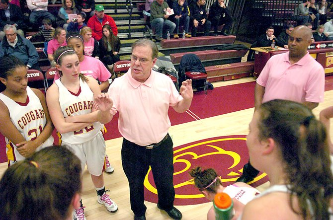 Oakton head girls’ basketball coach Fred Priester talks to the Cougars during a Jan. 18 game against Centreville at Oakton High School.