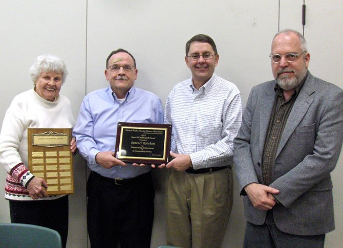 Jim Katcham (second from left) receives the James D. McDonnell Award from (from left) WFCCA Land-Use Committee member Judy Heisinger, Sully District Supervisor Michael Frey and Planning Commissioner Jim Hart.