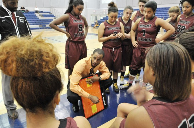 Mount Vernon girls' basketball coach Courtney Coffer talks to the Majors during a Jan. 17 contest against Washington-Lee.
