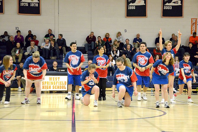 The Northern Virginia Special Olympics cheerleading team performed for the first time on Friday, Jan. 11, during halftime of the girls&#39; basketball game at WSHS. The crowd cheered and clapped along with the team. (Front row, from left) Jill Arnott, Ginger Fischer and Jacquelyn Hoffmeier; Back Row: Heather Savage, David Vonack, assistant coach Keiko Vonack, Brian Vonack and Samantha Cully.