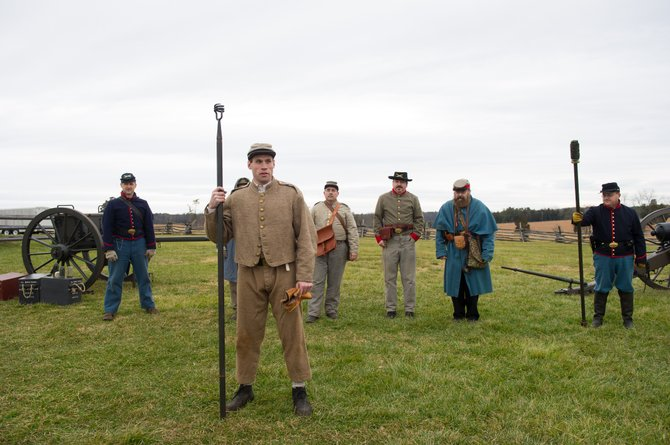 "The Infantry Division, from left: Rolf Madole of Clifton, Bob Brewer, Rob Griesbach of Ellicott City, Md., Neal West of Waldorf, Md., Paul Goss of Fairfax and Bryant Kincaid of Manassas, Va., participating in New Year's Day ""Living History"" at Manassas National Battlefield Park."