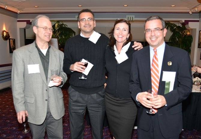 From left—Jeff Guzy, Guzy International Business Development, Carlos Pichardo, President Cap Ventures, Sarah Pichardo, VP Potomac Mortgage Group and Lou Muscarella, Century 21 New Millennium, represent a variety of local businesses at the i2B event.