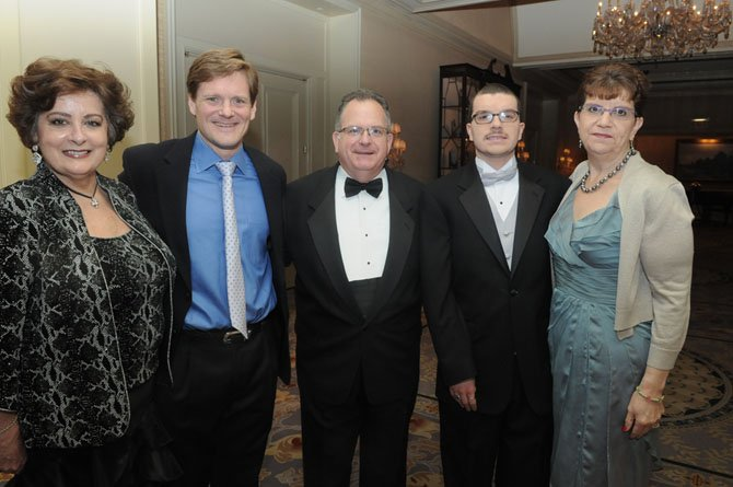 Patricia O'Hara, state Sen. Rob Krupicka, Scott, Joey and Linda McGeary.