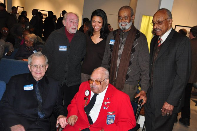 From left, Dudley Johnson, Reston founder Robert Simon, Jennifer Johnson, Hiram Mann, a member of the Tuskeegee Airmen, Tom Wilkins and Chuck Smith at the Martin Luther King Jr. Cultural Foundation's celebration at Herndon's ArtSpace Saturday, Jan. 26.