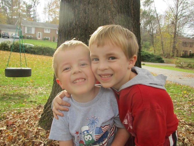 Pictured with his brother, 4-year-old John Gluck, diagnosed with a rare and severe form of muscular dystrophy, is rooting for doctors at the National Health Institute and throughout the world to find the cure to his degenerative muscular disease. Eat at Santinis Restaurant, 11804 Baron Cameron Ave., Reston, from 5-9 p.m. on Thursday, Feb. 7, and 15 percent of the bill supports Cure CMD. 