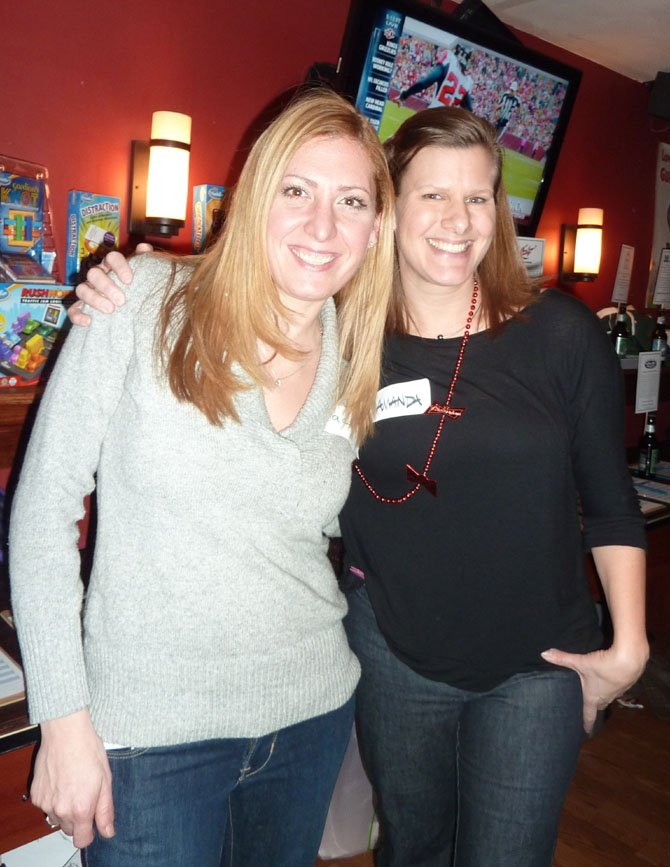 Jacki Donovan and Maj. Amanda Harrignton, board members of the Noble Argus Foundation, celebrate at a fundraiser Jan. 18 at The Light Horse restaurant. The organization provides scholarships and relief to families of Special Operations service members.