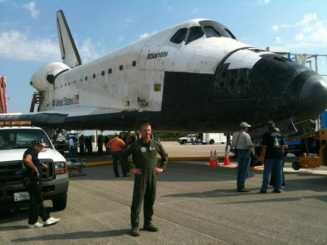 "Alexandria resident Col. Nathan ""Chili"" Lindsay is shown July 21, 2011 in front of the Space Shuttle Atlantis at NASA's Kennedy Space Center in Florida. The Atlantis mission STS-135 brought to an end the 30-year space shuttle program."