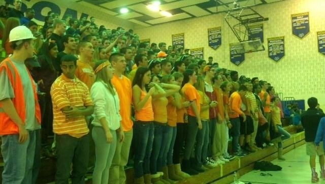 Students from the senior class of 2012 at an Orange-out for Leukemia at the Robinson boys' varsity basketball game on Friday, Dec. 7, 2012.