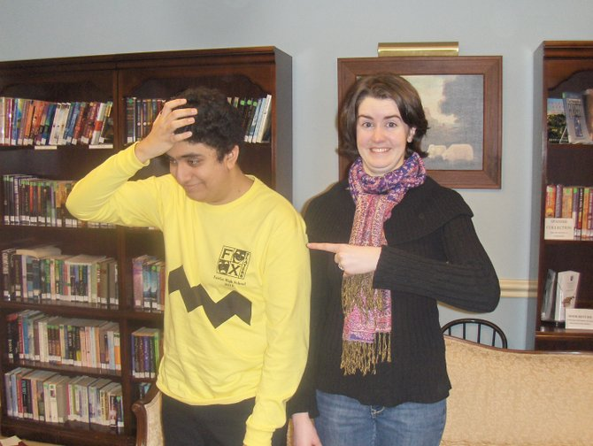 Charlie Brown (Shakil Azizi) is teased by Lucy (Isabelle Baucum).