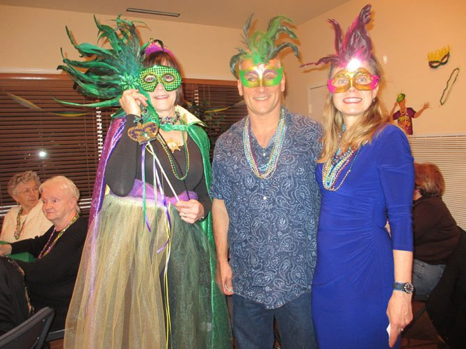"Mardi Gras ""Queen"" Margaret Dellinger with guests Steve and Desiree Sedgwick of Vienna, at Dan Dellinger's fundraiser on February 2."