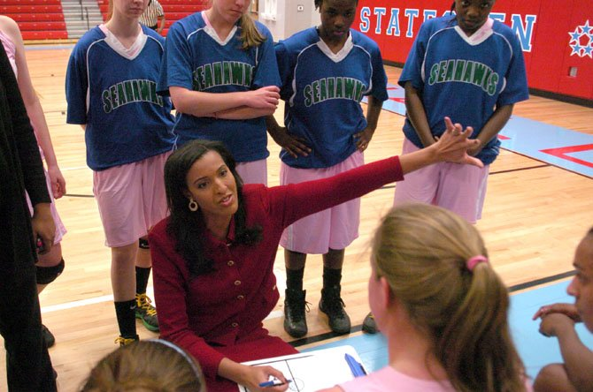 South Lakes girls' basketball coach Christy Winters-Scott has the Seahawks atop the Liberty District standings.