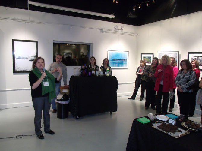 Catherine Powers speaking at the exhibition.