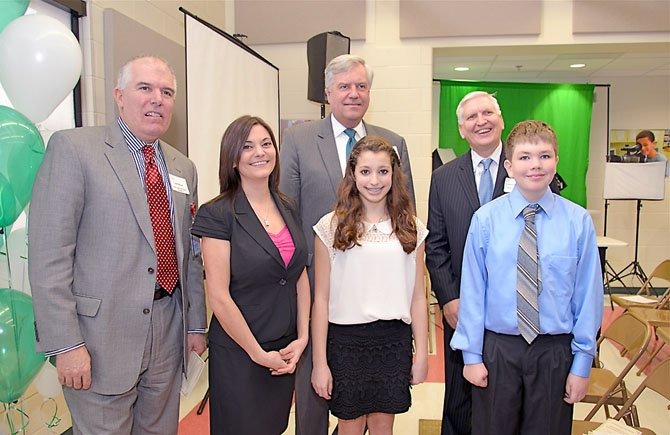Jim Kacur, assistant superintendent cluster 2, Fairfax County Public Schools, Superintendent Dr. Jack Dale, and Deputy Superintendent Dr. Richard Moniuszko were among the attendees at the Learning Lab dedication. The three school district officials take a moment to congratulate Wolftrap ES Principal Teresa Khuluki and sixth grade students Leah DeFreitas and Will Hertzler, who both presented original works created for the ceremony.