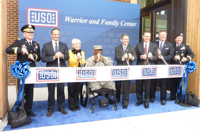 The USO Warrior and Family Center at Fort Belvoir officially opened Feb. 5. Participating in the ceremony are: Lt. Gen. William Troy, Kuwaiti ambassador Salem Abdullah Al-Jaber Al-Sabah, Elaine Rogers, Col. Gregory Gadson,  Sloan Gibson, Wes Bush, Ed Reilly and Gen. Frank Grass.