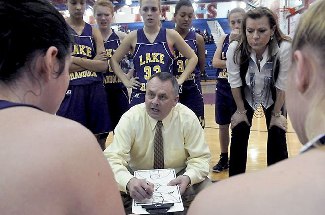 Lake Braddock girls' basketball coach John Giannelli talks to the Bruins during a Tuesday, Feb. 5, game at T.C. Williams.