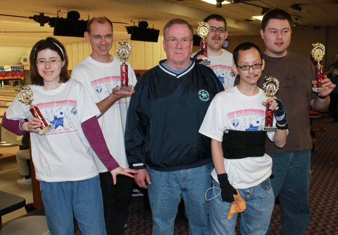 Five Special Olympians receive the Outstanding Performance Awards from FAS President John Carney.