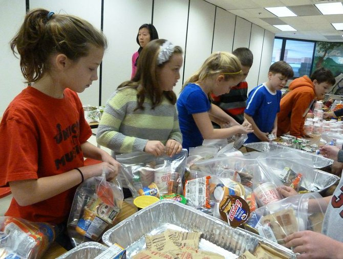 A hustling group of Union Mill fifth graders managed to assemble 248 weekend meal-packs or &quot;Weekend Power Packs&quot; for hungry children in the county.