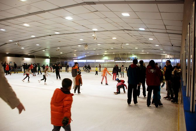 Men, women and children work up Super Bowl appetites skating around the rink at Fairfax Ice Arena.