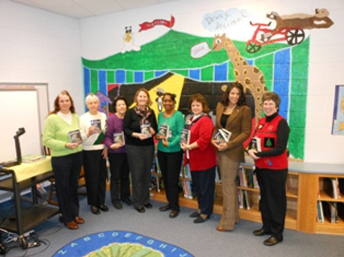 From left: Kimberley Harris Granahan, CRW past president; Kathleen Chevalier, recording secretary; Deborah Bodlander, 2012 CRW president; Lauren Sheehy, Hybla Valley Elementary School principal; Denise Pinchback, school librarian; Marguerite Saitta, assisant principal; Christina Schinner; Barbara Bush Literacy Project chair, and Lorraine Boyd, CRW corresponding cecretary.