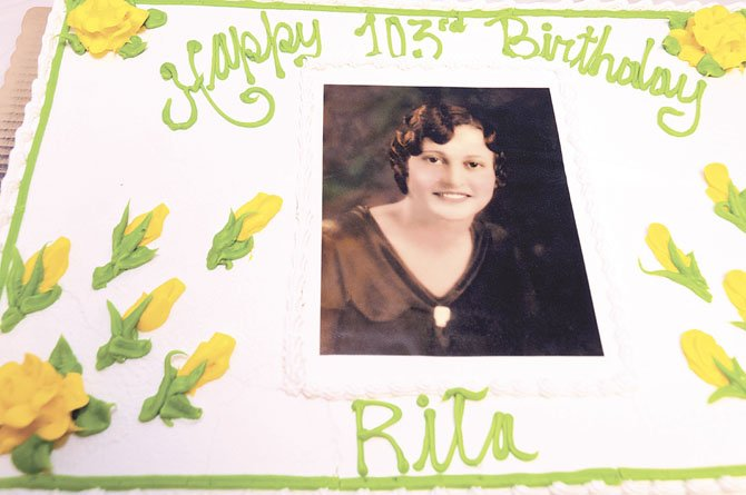 Rita De Lazzari, 103 years old (picture on cake was taken wheb Rita was 18 years old)