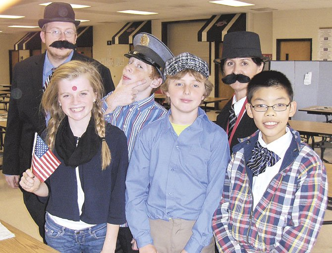 "Back row, from left, are history teacher Dan Vroman, ""Scottish policeman"" Ryan Morris and history teacher Jeanne Costello; (front row, from left) are ""Greek immigrants"" Annie Davis, Jared Brennan and Shaun Wu."