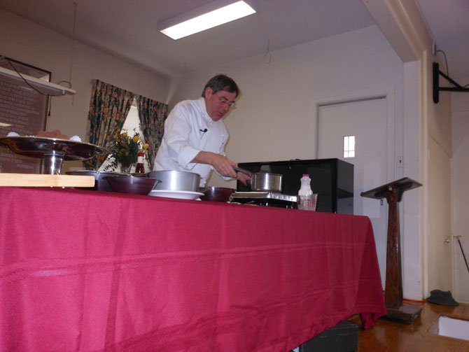 Chef Jacques Haeringer of L'Auberge Chez Francois shows guests at the Great Falls Senior Center February event how to make chocolate truffles.