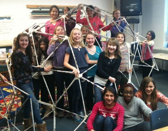 Churchill Road GEMS students Sarah Rice, Maya Kalidindi, Megan Vandre, Grace Ollivant, Sofie Stitt, Megan Markwart, Becca Schuette, Caroline Buttz, Sydney Marenburg, Alyssa Kalish, Maddie Rubin, Meg Guberman, Emily Wang and Amanda Riddle show off the geodesic dome they made as part of their math and engineering club project.