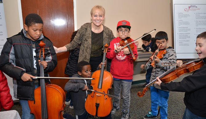 The youngsters from the Alternative House program are getting their musical tips from none other than the McLean Orchestra Music Director and Conductor Maestra Miriam Burns during the pre-show Musical Petting Zoo Hour.