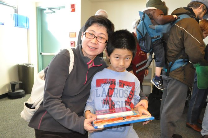 Corina Guo and Teddy Ye at the library's used book sale.